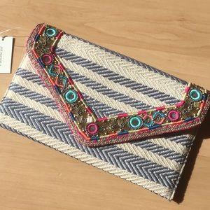 Francesca's clutch bag with shoulder strap